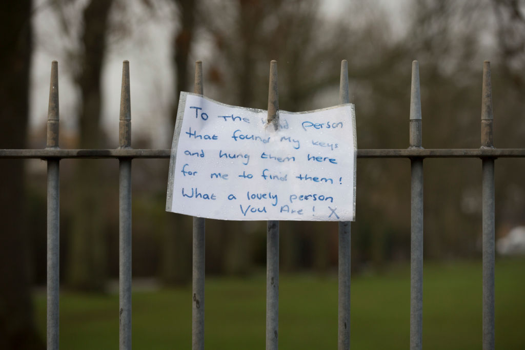 The owner of a set of keys, left on railings at an entrance to Ruskin Park in the south London-911043146