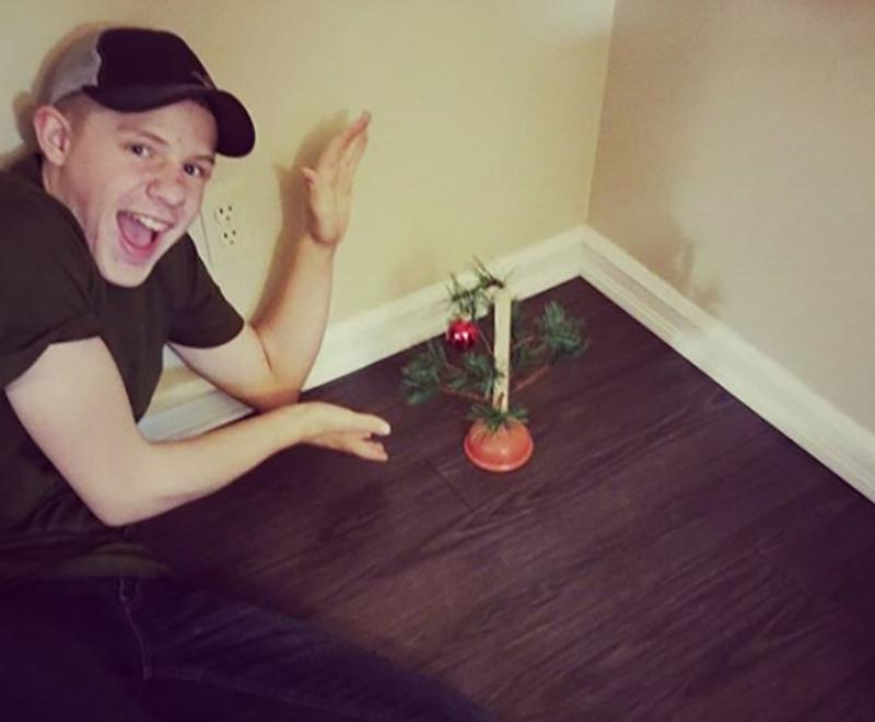 A small piece of a Christmas tree is fixed to a plunger.