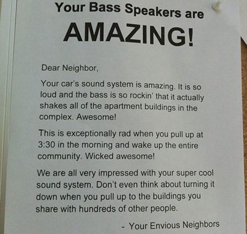 A note sarcastically compliments a neighbor's bass speaker.