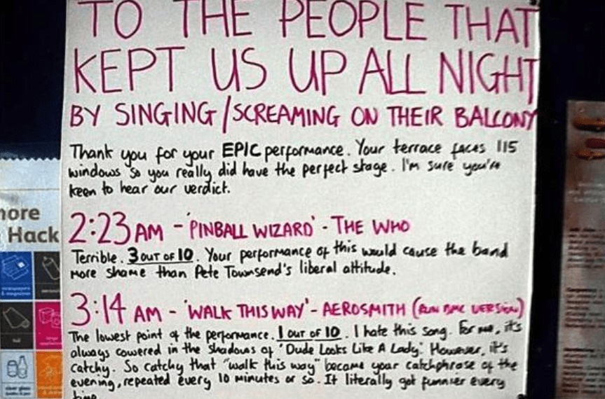 A sign rates each song that was overheard being belted out the night prior.