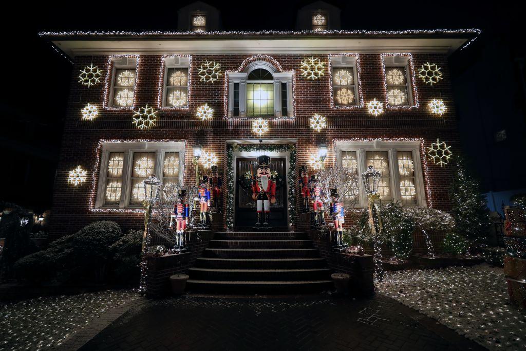 Christmas lights adorn a home's exterior.