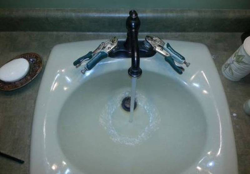 Two clamps replace handles on the sink.