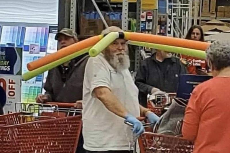 A man attached pool noodles to a headband to keep others six feet away.