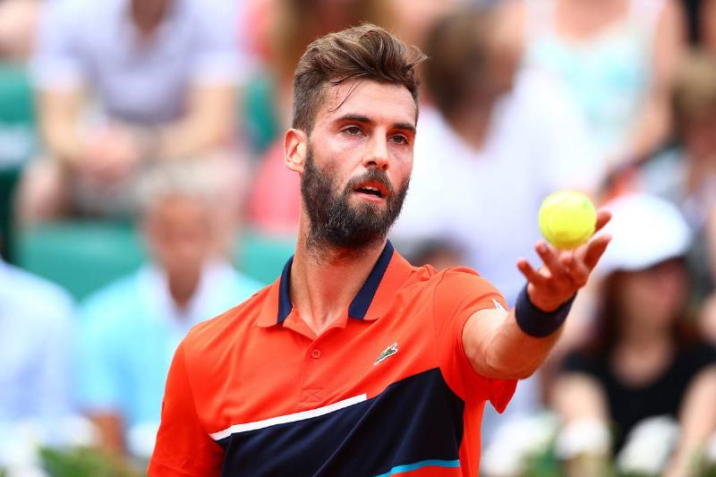 Benoit Paire Serving The Ball As An Offering